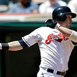 Cleveland Indians' Jason Kipnis hits a sacrifice fly to drive in a run against the Oakland Athletics in the second inning of a baseball game Thursday, May 9, 2013, in Cleveland. (AP Photo/Ma …