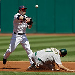Cleveland Indians second baseman Jason Kipnis throws over Oakland Athletics' Adam Rosales but can't complete the double play on Jed Lowrie in the first inning of a baseball game Thursday, Ma …