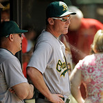 Oakland Athletics manager Bob Melvin, center, looks on from the dugout in the seventh inning of a baseball game against the Cleveland Indians Thursday, May 9, 2013, in Cleveland. The Athleti …