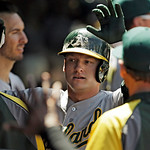 Oakland Athletics' Josh Donaldson is greeted in the dugout after hitting a solo home run off Cleveland Indians starting pitcher Scott Kazmir in the sixth inning of a baseball game Thursday,  …