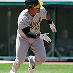 Oakland Athletics' Michael Taylor singles in the fifth inning of a baseball game against the Cleveland Indians Thursday, May 9, 2013, in Cleveland. (AP Photo/Mark Duncan)