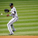 Chicago White Sox's Alexei Ramirez fields a ball in a baseball game against the Cleveland Indians, Monday, Oct. 1, 2012, in Cleveland. (AP Photo/Tony Dejak)