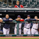 Members of the Cleveland Indians watch from the dugout a baseball game against the Chicago White Sox, Monday, Oct. 1, 2012, in Cleveland. (AP Photo/Tony Dejak)