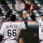Chicago White Sox's Dayan Viciedo, right, is congratulated by A.J. Pierzynski, left, and Ray Olmedo after Viciedo hit a grand slam in the ninth inning of a baseball game, Monday, Oct. 1, 201 …