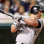 Chicago White Sox designated hitter Adam Dunn hits an RBI-single off Cleveland Indians starting pitcher Corey Kluber in the sixth inning of a baseball game, Monday, Oct. 1, 2012, in Clevelan …