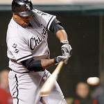Chicago White Sox's Dayan Viciedo hits a grand slam in the ninth inning of a baseball game against the Cleveland Indians, Monday, Oct. 1, 2012, in Cleveland. A.J. Pierzynski,  Ray Olmedo and …