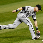 Chicago White Sox's Gordon Beckham stretches for a single hit by Cleveland Indians' Shin-Soo Choo in the third inning of a baseball game, Monday, Oct. 1, 2012, in Cleveland. (AP Photo/Tony D …