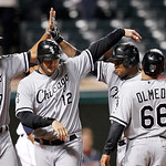 Chicago White Sox's left fielder Dayan Viciedo, right, is congratulated by Jordan Danks, A.J. Pierzynski, left, and Ray Olmedo after Viciedo hit a grand slam in the ninth inning of a basebal …