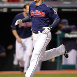 Cleveland Indians' Lonnie Chisenhall scores on a sinble by Jason Donald in the 12th inning of a baseball game against the Chicago White Sox, Tuesday, Oct. 2, 2012, in Cleveland. The Indians  …