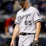 Chicago White Sox's Nate Jones walks back to the dugout after Cleveland Indians' Jason Donald hit an RBI single off Jones in the 12th inning of a baseball game, Tuesday, Oct. 2, 2012, in Cle …