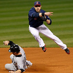 Cleveland Indians second baseman Jason Kipnis, right, throws to first base in the fourth inning of a baseball game against the Chicago White Sox, Tuesday, Oct. 2, 2012, in Cleveland. Chicago …