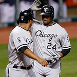 Chicago White Sox's Dayan Viciedo, right, is congratulated by Jose Lopez after Viciedo hit a two-run home run off Cleveland Indians relief pitcher Chris Perez in the ninth inning of a baseba …