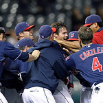 Cleveland Indians' Jason Donald, center, is mobbed by teammates after hitting the game-winning single off Chicago White Sox pitcher Nate Jones in the 12th inning of a baseball game, Tuesday, …
