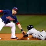 Cleveland Indians shortstop Asdrubal Cabrera, left, waits for the ball as Chicago White Sox's Orlando Hudson slides safely into second base on a steal in the first inning of a baseball game, …