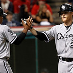 Chicago White Sox's Dan Johnson, right, is congratulated by Dayan Viciedo after Johnson hit a two-run home run off Cleveland Indians starting pitcher David Huff in the fifth inning of a base …