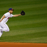 Cleveland Indians' Cord Phelps stretches for a ground ball in a baseball game against the Chicago White Sox, Wednesday, Oct. 3, 2012, in Cleveland. (AP Photo/Tony Dejak)