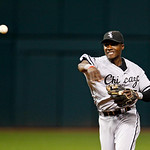 Chicago White Sox's Orlando Hudson throws to first base in a baseball game against the Cleveland Indians, Wednesday, Oct. 3, 2012, in Cleveland. (AP Photo/Tony Dejak)