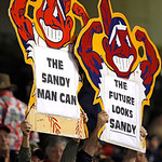 Indians fans hold up signs relating to interim manager Sandy Alomar Jr. in a baseball game between the Chicago White Sox and the Cleveland Indians, Wednesday, Oct. 3, 2012, in Cleveland. (AP …