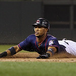 Minnesota Twins' Pedro Florimon slides safely into third base on a triple against Cleveland Indians starting pitcher Justin Masterson during the sixth inning of a baseball game, Monday, Sept …