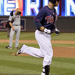 Minnesota Twins' Ryan Doumit heads to home  after hitting a solo home run against Cleveland Indians relief pitcher Frank Herrmann, back left, during the eighth inning of a baseball game, Mon …