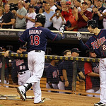 Minnesota Twins' Ryan Doumit is congratulated by teammate Trevor Plouffe (24) after hitting a solo home run against Cleveland Indians relief pitcher Frank Herrmann during the eighth inning o …