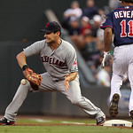 Cleveland Indians first baseman Casey Kotchman, left, makes the out on Minnesota Twins' Ben Revere (11) during the first inning of a baseball game, Monday, Sept. 10, 2012, in Minneapolis. (A …
