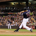 Minnesota Twins' Justin Morneau (33) hits a sacrifice fly to score Alexi Casilla against Cleveland Indians starting pitcher Justin Masterson during the fourth inning of a baseball game, Mond …