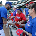 Texas Rangers' Mike Adams signs autographs for fans following batting practice before a baseball game against the Cleveland Indians Tuesday, Sept. 11, 2012, in Arlington, Texas. The Rangers  …