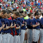 Members of the Cleveland Indians stand during a moment of silence in observance of the Sept. 11, 2001 terrorist attack before a baseball game against the Texas Rangers Tuesday, Sept. 11, 201 …