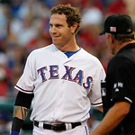 Texas Rangers' Josh Hamilton talks to home plate umpire Ed Hickox during a baseball game against the Cleveland Indians Tuesday, Sept. 11, 2012, in Arlington, Texas. The Rangers won 6-4. (AP  …