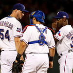 Texas Rangers' Matt Harrison (54) gets a visit from catcher Geovany Soto (8) and manager Ron Washington, right, in the sixth inning of a baseball game against the Cleveland Indians Tuesday,  …
