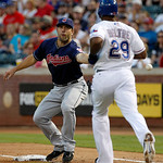 Cleveland Indians third baseman Russ Canzler is unable to handle the throw from third as Texas Rangers' Adrian Beltre (29) reaches first safely in the second inning of a baseball game Tuesda …