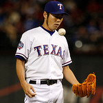 Texas Rangers' Koji Uehara of Japan waits to be pulled from the game after facing a batter in the eighth inning of a baseball game against the Cleveland Indians Tuesday, Sept. 11, 2012, in A …
