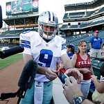 Texas Rangers closer Joe Nathan, dressed as Dallas Cowboys quarterback Tony Romo (9), signs autographs for fans following batting practice before a baseball game against the Cleveland Indian …