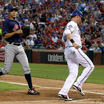 Cleveland Indians' Ubaldo Jimenez watches as Texas Rangers' Michael Young scores on a wild pitch by Jimenez in the second inning of a baseball game Tuesday, Sept. 11, 2012, in Arlington, Tex …