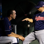 Cleveland Indians starting pitcher Ubaldo Jimenez, left, talks with pitching coach Ruben Niebla, right, in the third inning of a baseball game against the Texas Rangers Tuesday, Sept. 11, 20 …