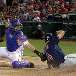Texas Rangers catcher Geovany Soto (8) is unable to tag Cleveland Indians' Russ Canzler (4) who scored on a Matt LaPorta double in the sixth inning of a baseball game Tuesday, Sept. 11, 2012 …