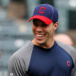 Cleveland Indians' Ubaldo Jimenez (30) smiles as he chats with teammates during batting practice before a baseball game against the Texas Rangers Thursday, Sept. 13, 2012, in Arlington, Texa …