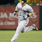 Cleveland Indians' Matt LaPorta cricles the bases after hitting a two-run home run off Texas Rangers' Derek Holland in the sxith inning of a baseball game on Thursday, Sept. 13, 2012, in Arl …