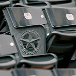 The Texas Rangers logo is seen on the seats at the Texas Rangers ballpark before a baseball game against the Cleveland Indians Thursday, Sept. 13, 2012, in Arlington, Texas. (AP Photo/Tony G …