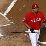 Texas Rangers' Nelson Cruz heads back to the dugout after striking out against Cleveland Indians' Zach McAllister during a baseball game Thursday, Sept. 13, 2012, in Arlington, Texas. The In …