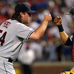 Cleveland Indians closer Chris Perez (54) celebrates with catcher Carlos Santana, right, following their 5-4 win against the Texas Rangers in a baseball game Thursday, Sept. 13, 2012, in Arl …
