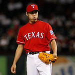 Texas Rangers' Koji Uehara (19) of Japan sighs between pitches to the Cleveland Indians during a baseball game Thursday, Sept. 13, 2012, in Arlington, Texas. The Indians won 5-4. (AP Photo/T …