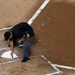 Umpire Mark Carlson clears the plate before a baseball game between the Texas Rangers and Cleveland Indians  Thursday, Sept. 13, 2012, in Arlington, Texas. The Indians won 5-4. (AP Photo/Ton …
