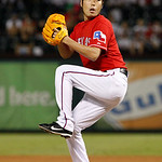 Texas Rangers relief pitcher Koji Uehara (19) of Japan winds up to deliver to the Cleveland Indians a baseball game Thursday, Sept. 13, 2012, in Arlington, Texas. The Indians won 5-4. (AP Ph …