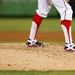 Texas Rangers' Derek Holland on the mound against the Cleveland Indians during a baseball game Thursday, Sept. 13, 2012, in Arlington, Texas. The Indians won 5-4. (AP Photo/Tony Gutierrez)