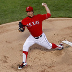 Texas Rangers starting pitcher Derek Holland (45) delivers to the Cleveland Indians in the first inning of a baseball game on Thursday, Sept. 13, 2012, in Arlington, Texas. (AP Photo/Tony Gu …