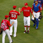 Texas Rangers' Martin Perez, from bottom left, Michael Kirkman (50), Derek Holland and Geovany Soto, top right, greet each other in the outfield before a baseball game against the Cleveland  …