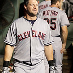Cleveland Indians' Matt LaPorta smiles as he walks through the dugout after hitting a two-run home run that also scored Vinny Rottino off a pitch from Texas Rangers' Derek Holland in the six …