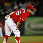 Texas Rangers starting pitcher Derek Holland (45) prepares to deliver to the Cleveland Indians during a baseball game Thursday, Sept. 13, 2012, in Arlington, Texas. The Indians won 5-4. (AP  …
